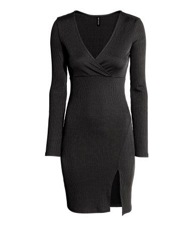 Black. Short dress in soft, ribbed jersey with a wrapover top, seam under the…