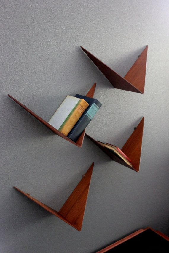 Vintage and extremely rare Poul Cadovius Butterfly Shelving set of 4. Beautiful, sculptural and functional. These clean-lined, minimalist shelves can
