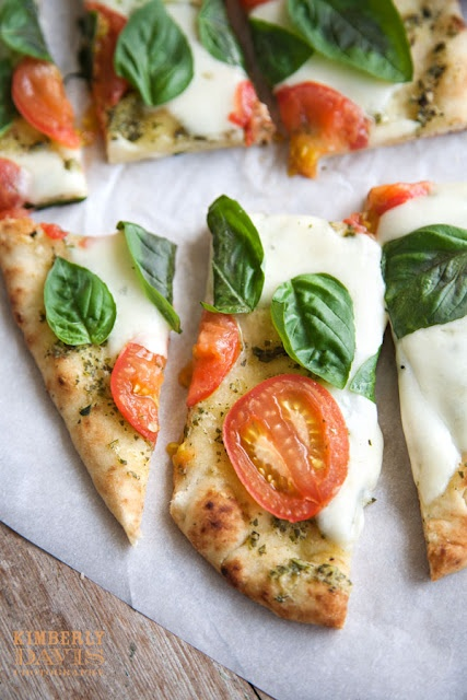 pesto, basil, tomato and mozarella naan pizza--seriously delicious...especially with my mom's homemade pesto for the sauce : )