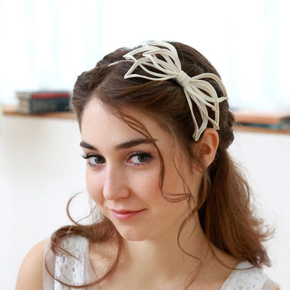 STYLE - #202 CODE:HDB018 Wired bloom headband is made of crepe de chine piping, wire is inserted and hand-shaped to lovely floral shape. To order yours, contact us on loca@localoca.co.za www.localoca.co.za