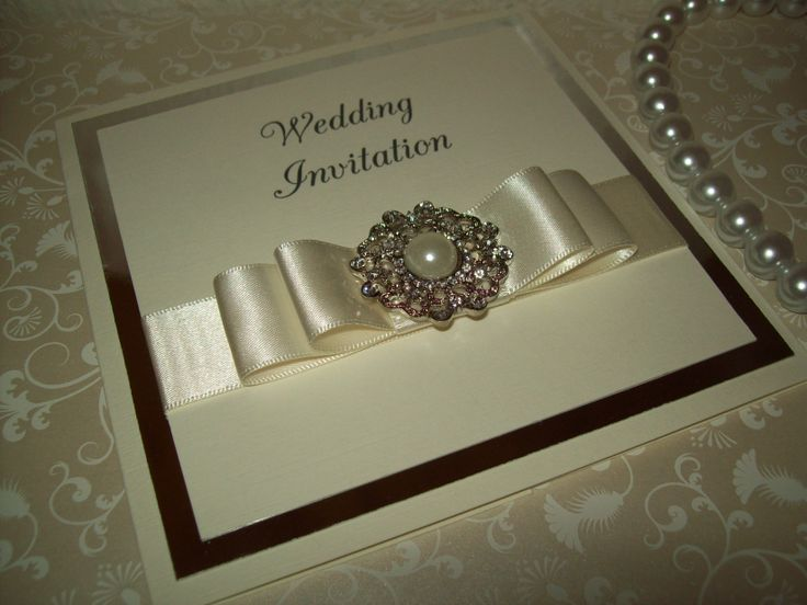 A simple yet very elegant pearl and diamante wedding invitation in ivory