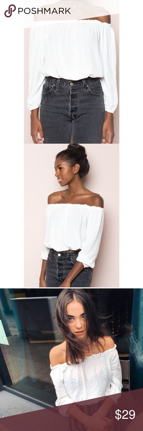 "🆕 Brandy Melville White Maura Top Soft woven cotton off-the-shoulder top in white with elasticized shoulders, sleeves and hem with ruffled trimmings and a cropped fit. Fabrics: 100% viscose Measurements: 15"" length, 15"" bust  ⭐️⭐️⭐️⭐️⭐️ Rating 💯 Shop with confidence  📦 Ship same day / next day 🆓 Brandy Melville stickers w/ purchase  🛍 Bundle & save ⛔️ trades ⛔️ lowball offers Brandy Melville Tops Blouses"