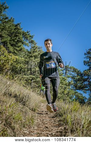 young male athlete runs from mountain