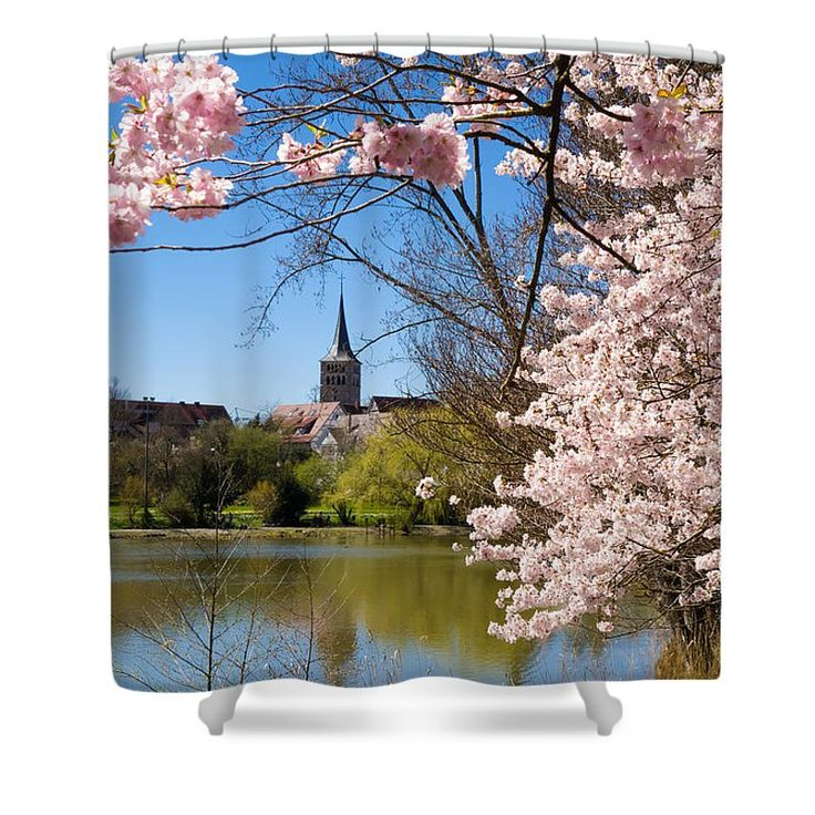 """Sindelfingen Duschvorhang / shower curtain: Sunny spring day in Sindelfingen Germany, lovely pink Cherry blossoms, a lake and a church (Martinskirche). This shower curtain is made from 100% polyester fabric and includes 12 holes at the top of the curtain for simple hanging. The total dimensions of the shower curtain are 71"""" wide x 74"""" tall. Matthias Hauser hauserfoto.com - Art for your Home Decor and Interior Design needs."""