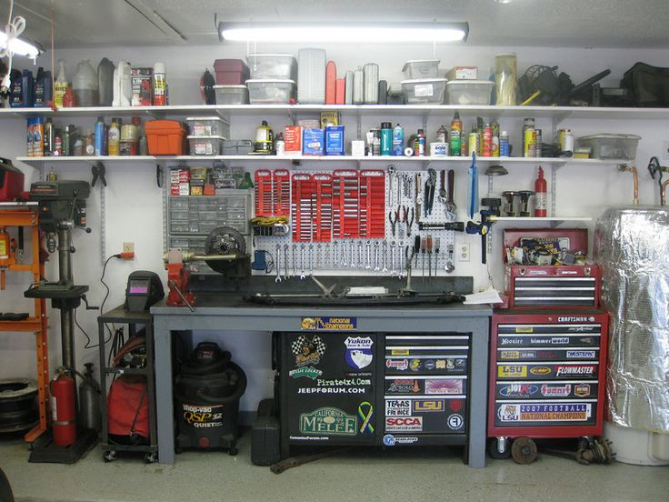 Peg Board, Welding Cart, Shelves Everywhere.