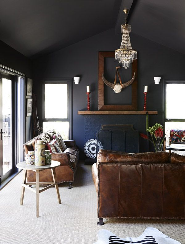 Sitting Room – Old battered leather couches ('great with kids' says Kristan!).  Wall colour – Dulux Domino.  Photo - Eve Wilson, styling - A...