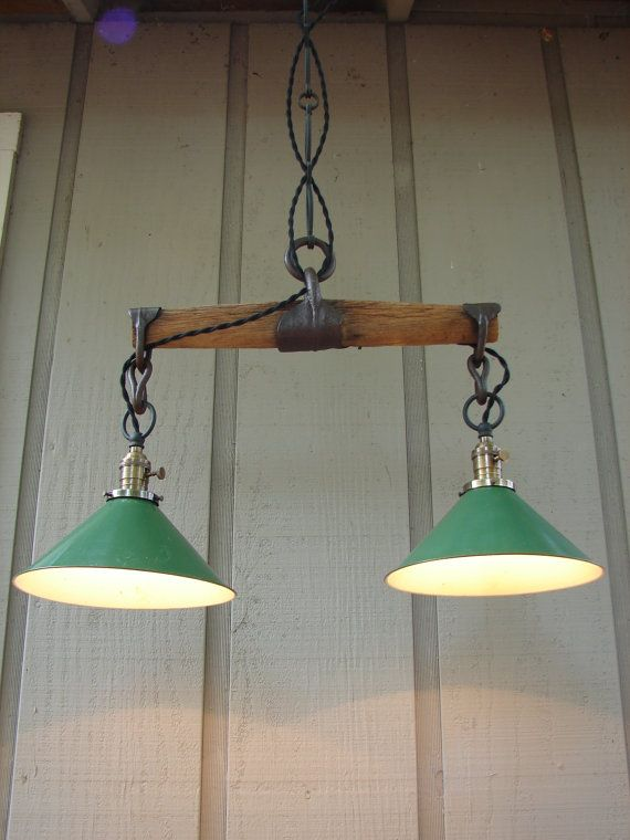 Upcycled Vintage Wooden Yoke Pendant with Vintage Industrial Shop Shades. $299.00, via Etsy.