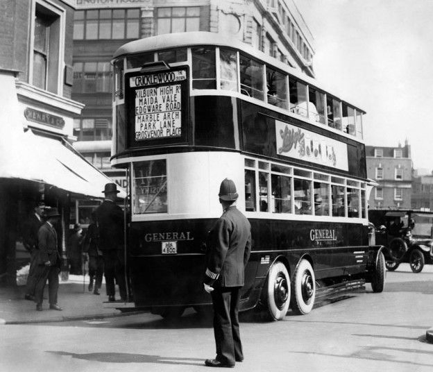 aption:The luxury travelling for the general public, the new six wheel pneumatic double decker omnibus pictured in the 1920s on the first tr...