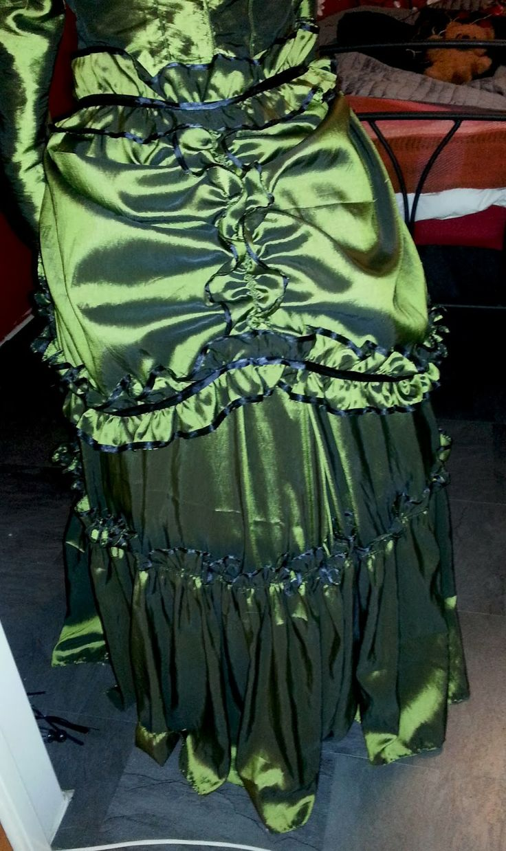 The back of my green victorian taffeta dress with black trimmings.