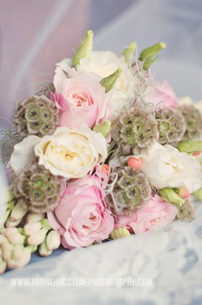 Tear-drop bouquet with David Austin roses, eustoma and seed pods for texture. By Tarnia Williams - Flower for Weddings