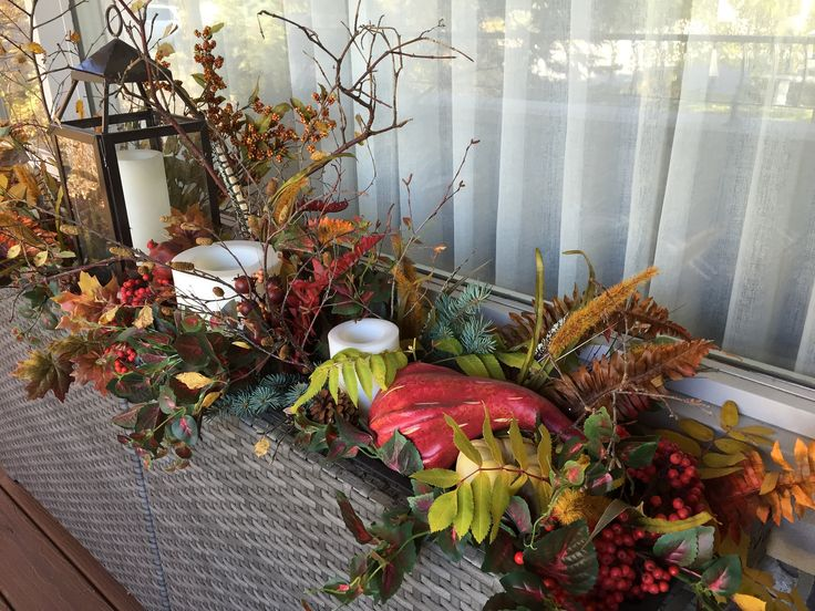 outdoor arrangement for Autumn with candles and gourds