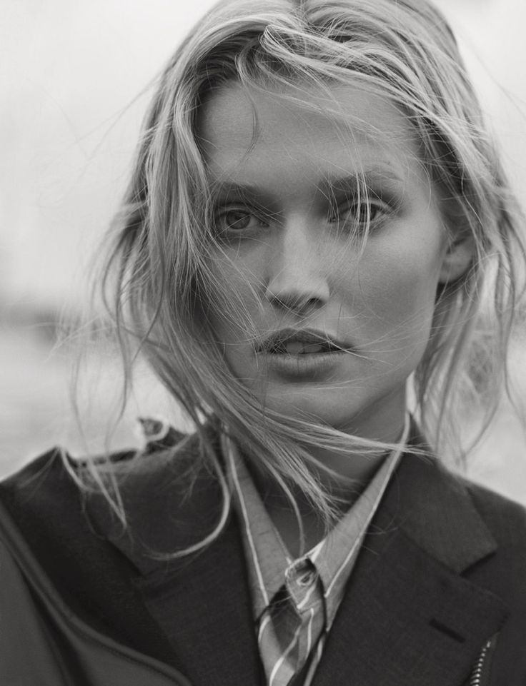 Getting her closeup, Toni Garrn wears a suit jacket with an undone hairstyle