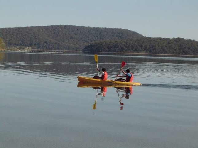 Kayaking with friends in Smiths Lake while on holiday. http://www.ozehols.com.au/blog/new-south-wales/holiday-homes-in-smiths-lake-to-explore-legendary-mid-north-coast/ Mid North Coast of NSW offer plenty of adventure. #visitmidnorthcoast #midnorthcoastholidays