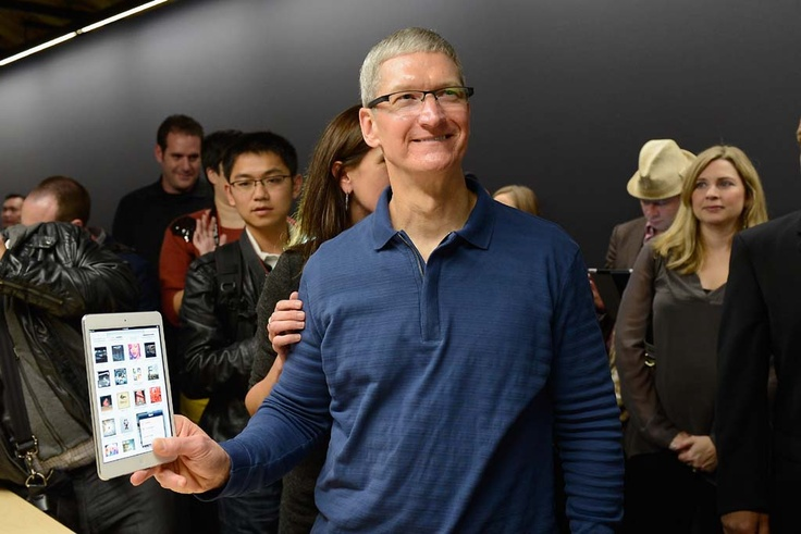 Apple CEO Tim Cook shows off the iPad mini.