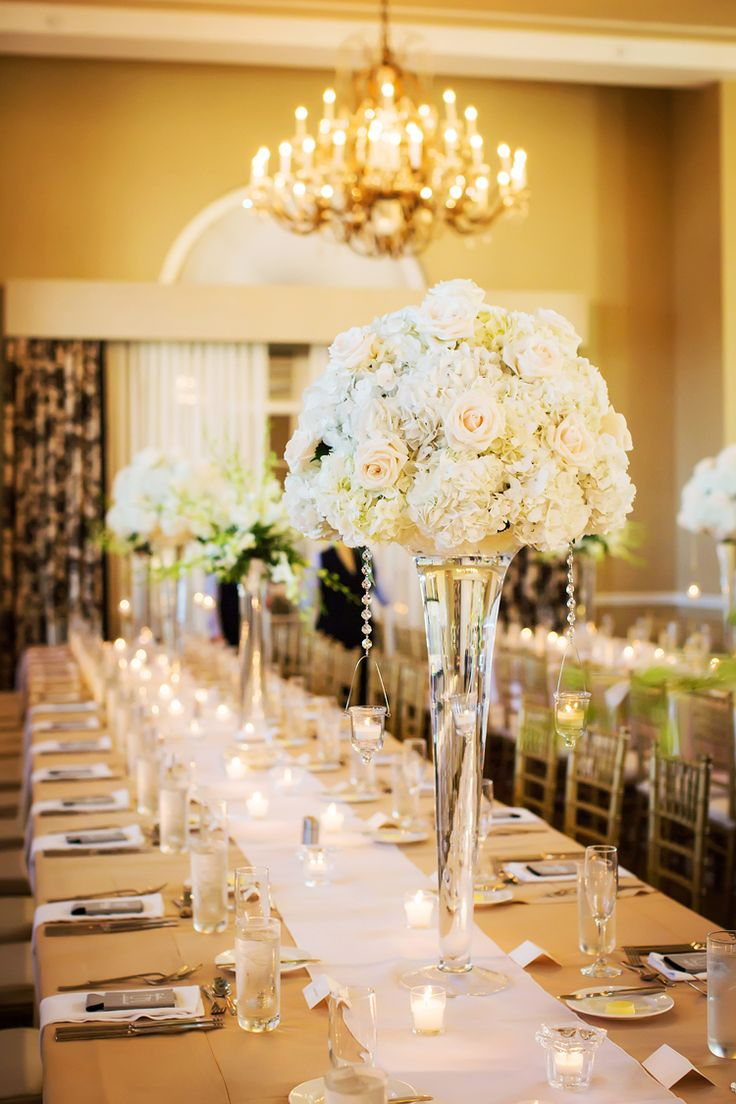 Tall monochrome white wedding centerpieces | Long wedding tablescape ideas (Limelight Photography)