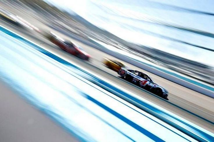 Kevin Harvick, driver of the #4 Jimmy John's/ Budweiser Chevrolet, leads a pack of cars during the NASCAR Sprint Cup Series CampingWorld.com 500 at Phoenix International Raceway on March 15, 2015 in Avondale, Ariz.