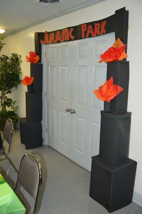 Jurassic Park GATE Entrance!          Used poster board, stables, tissue paper, tape,  and construction paper for the letters.