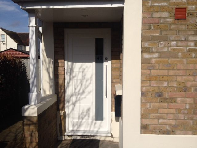 Off white contemporary timber door with sandblast effect vision panel and guardsman stainless steel handle