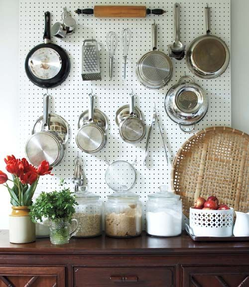 Sheets of pegboard create a functional - yet chic - storage space in the kitchen.