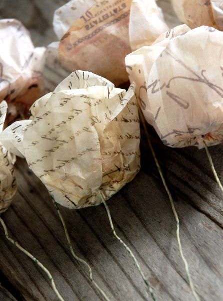 french script parchment paper roses with metal wire stems (possible candidate for centerpieces with orange flowers mixed in)