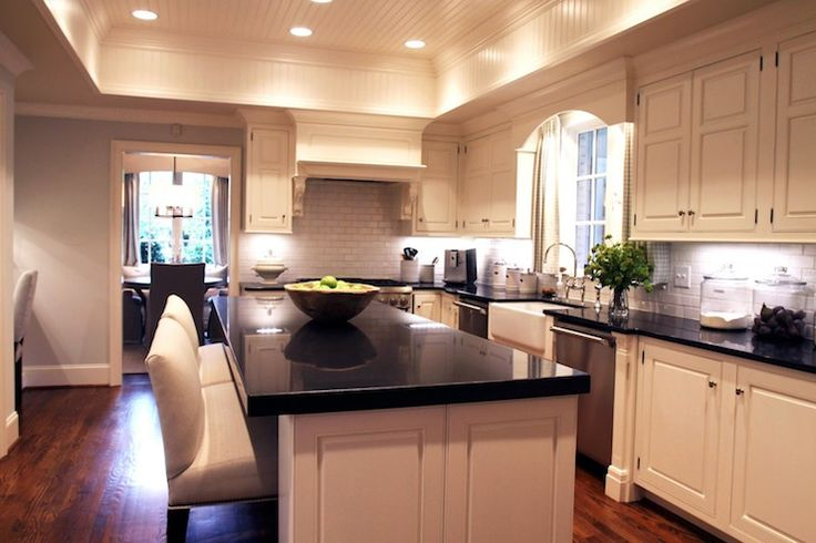 Tray beadboard ceiling creamy white kitchen cabinets for White kitchen cabinets with black galaxy granite