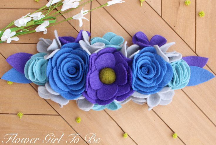 A personal favorite from my Etsy shop https://www.etsy.com/listing/596518677/blue-floral-crown-flower-girl-hair