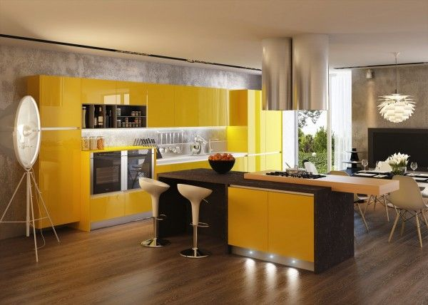 Fun sunshine yellow gloss units are mixed with a more serious looking black countertop on the central island in this one, but a light wood countertop add-on keeps things looking friendly. A dark lined cubby compartment ties the island in with the side run of cupboards, as well as topping the black glass fronted cookers perfectly.