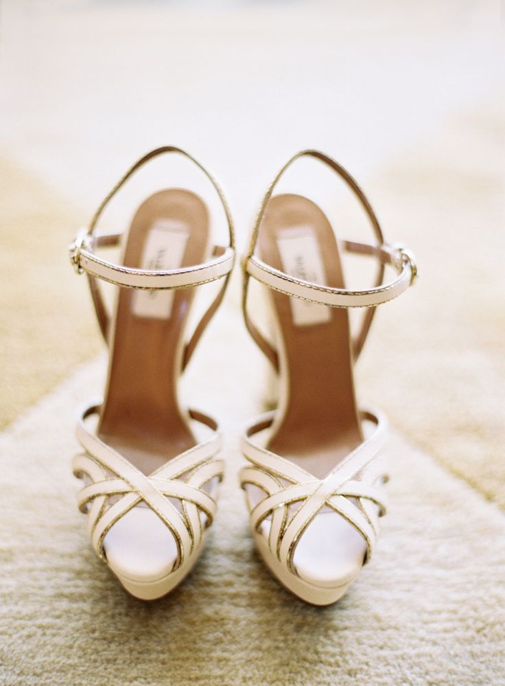 Strappy sandals: http://www.stylemepretty.com/2015/08/16/neutral-shoes-that-pair-pretty-with-any-wedding-dress/
