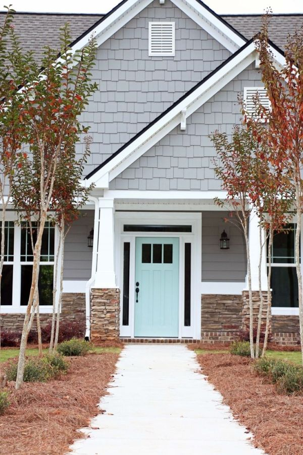 Home exterior colors - Light gray house with mint door by ivy