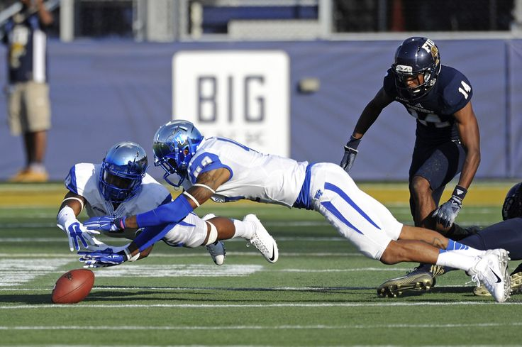 15 November 2014:  Middle Tennessee linebacker Trey Wafford (8) and Middle Tennessee safety Xavier Walker (42) dive after an FIU fumble in the first quarter as the FIU Golden Panthers defeated the Middle Tennessee Blue Raiders, 38-28, at FIU Stadium in Miami, Florida.
