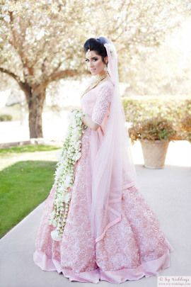 Bridal Wear - Sandeep & Natasha wedding story   WedMeGood   Bride in a Monotone Pink Lehenga with Floral Kaleere  #wedmegood #indianbride #indianwedding #bridalwear #indianweddingjewelry #realwedding #floralkaleere #uniquekaleere #kaleere