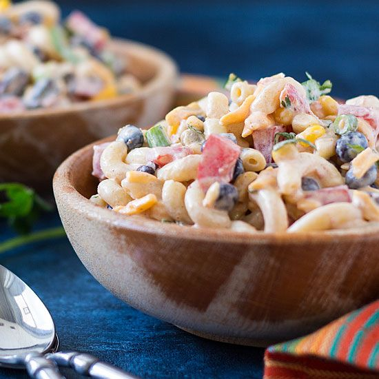 Pasta in a creamy taco sauce with RO*TEL and taco toppings.