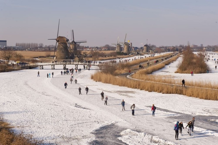 Ice skating in the Netherlands. Whenever the weather allows it, half of the Dutch population hurries towards the frozen waters and gets on their ice skates.