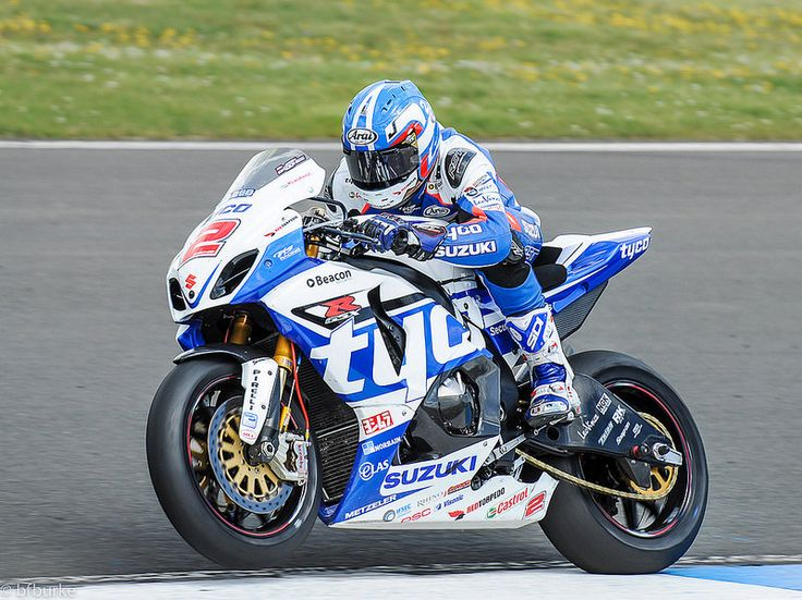 Josh Brookes - Tyco Suzuki  Pulling out of the corner, the throttle is increased whilst the front wheel starts to lift.