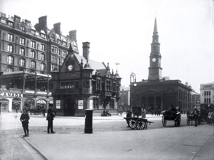 A sunny afternoon in St Enoch Square, early 20th century.  The entrance to the Glasgow & South Western Railway Co's St Enoch Station is on the left. The St Enoch Hotel was built over the station entrance in 1875 and its facade ran along one side of the square. St Enoch's Church (rebuilt in 1827 but retaining its distinctive spire) occupied the south side of the square. The St Enoch Shopping Centre was built on the site of the station and hotel in the 1980s. The church was demolished in 1925.