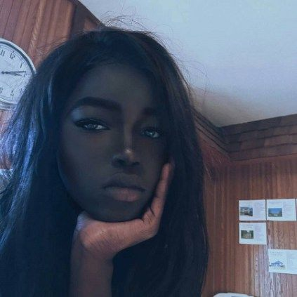 This is the model who has become an online sensation because of the color of her skin.    Her name is Lolita and she calls herself the black Hannah Montana.    The young lady has a skin that is
