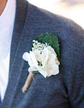 Boutonniere: Silk white hydrangea blossoms, fresh babies breath, silk hydrangea leaf wrapped in twine.
