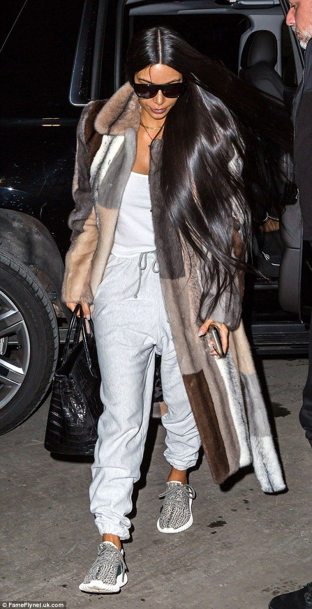 The siren didn't need the help of a brassiere as she stepped out in with her pal Simon Huck and a trusty bodyguard. The 36-year-old Keeping Up With The Kardashians star also flashed her toned legs