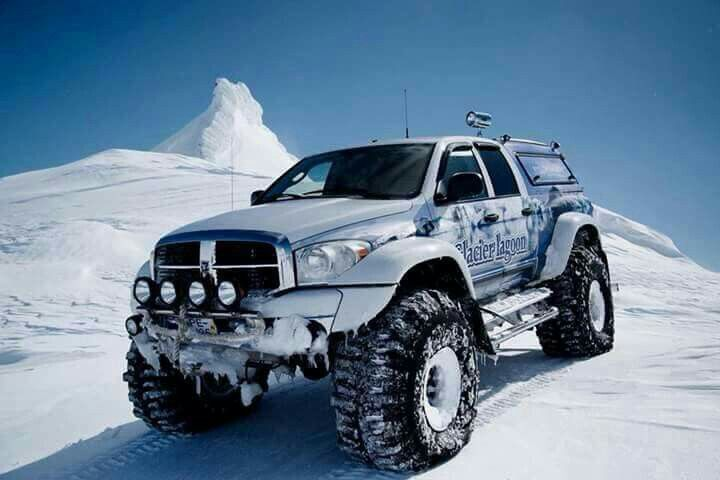 Dodge Ram - Quad Cab ~modified; lift kit; quad-fog lights; tow package; fender wheel wells; over-sized tires; Glacier l'agoon; winter ride!
