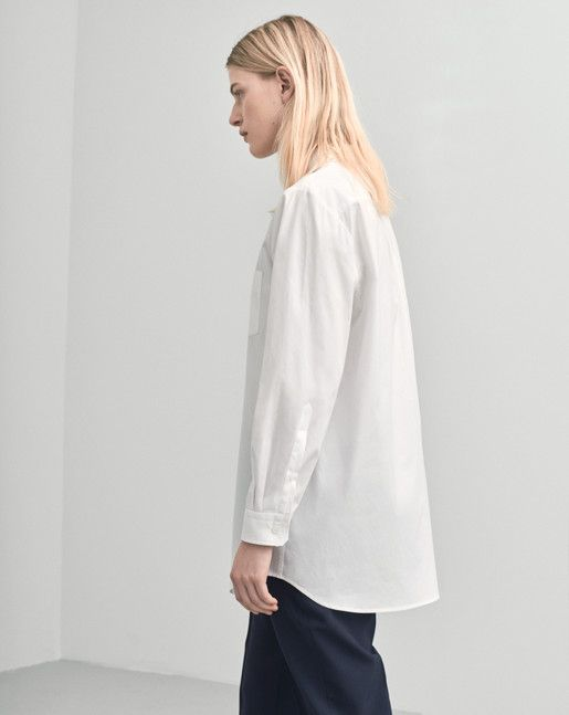 A slightly oversized longer shirt in organic cotton with a button down detail at the top of the collar. Clean minimal detailing and single chest pocket. <br><br> - Organic cotton<br> - Oversized fit<br> - Button down detail<br><br>  The model is 175c