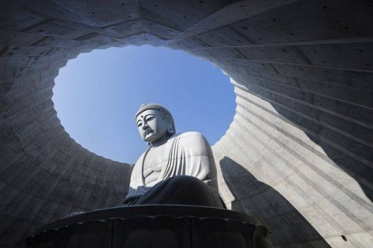 Located in the outskirts of Sapporo, the Makomanai Cemetery has a large stone Buddha occuping the sprawling landscape. All 1,500 tons of it has sat alone there for 15 years. But when the cemetery decided they wanted to do something to increase visitor's appreciations for the Buddha, they enlisted architect Tadao Ando, who had a grand and bold idea: hide the statue.