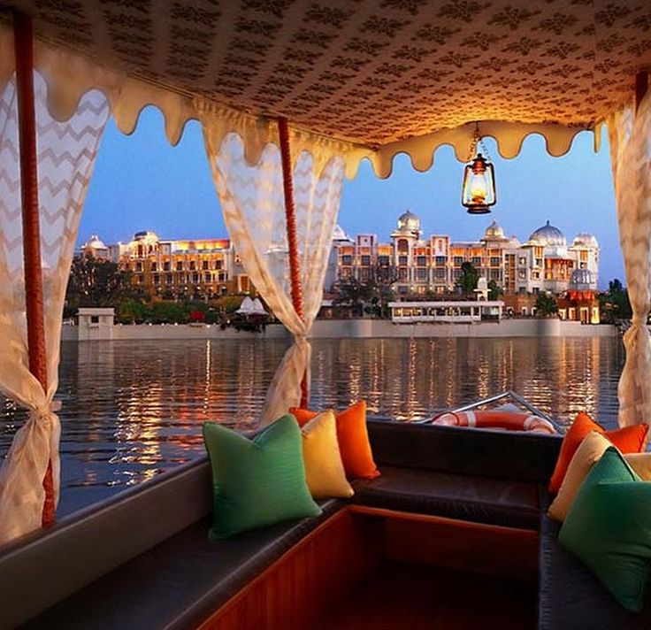 Boating through Udaipur's magnificent beauty.