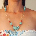 """This unique piece is a handmade gem. It is composed of turquoise in various shapes, coral ruby stones and sterling silver wire beautifully strung into """" 8 """" shape."""