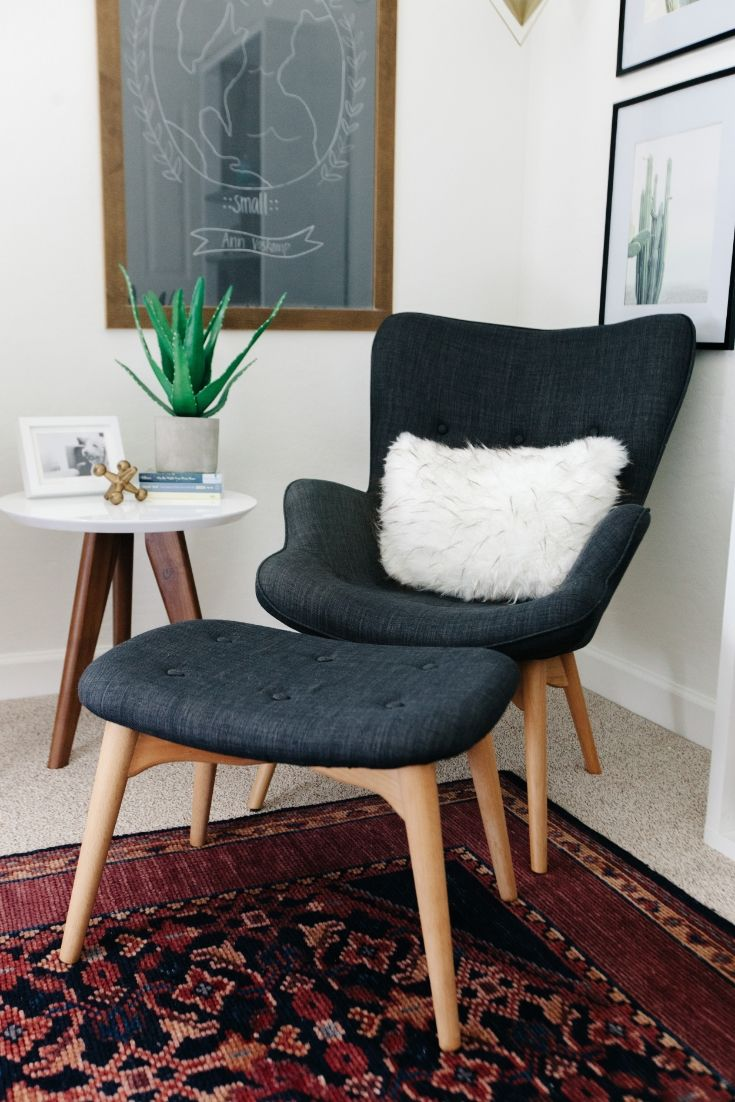 gray wingback modern chair and foot stool