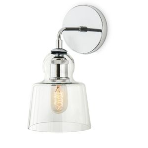 A vintage classic made modern, the Hoyt wall sconce highlights the simple utility of great industrial design. Finished in Chrome, this updated reproduction look will harmonize impeccably in either contemporary or transitional bathrooms, kitchens, and hallways.