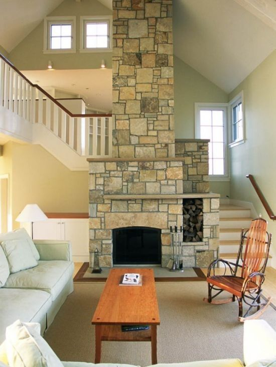 Coastal Living Room Ideas | love how the stairs go behind the fireplace