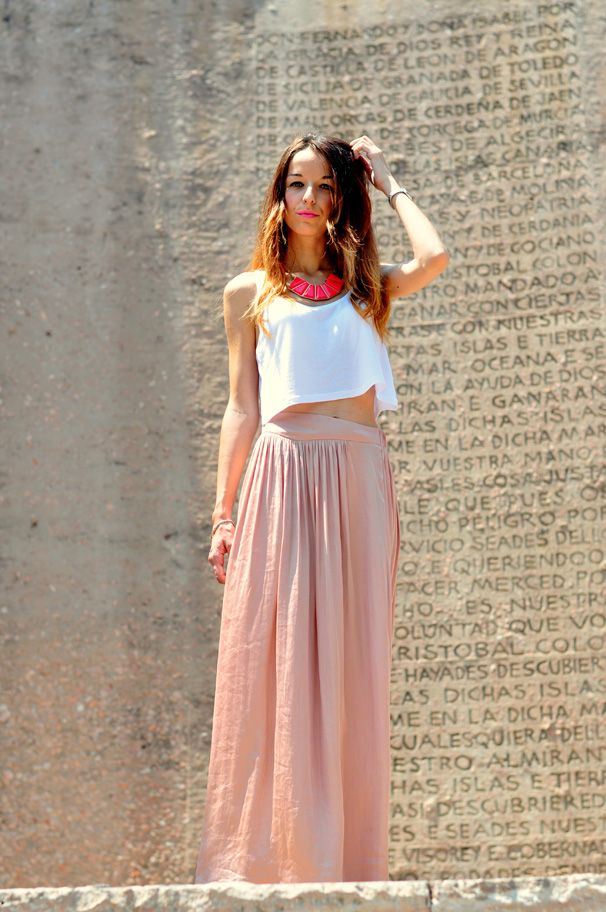 White crop top with light pink maxi skirt and statement necklace