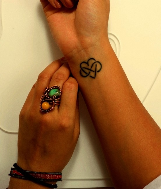 Love to Infinity, I love this. I want this tattoo but not on my wrist.