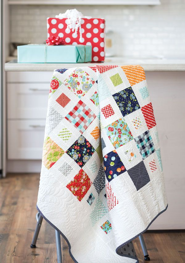 """This contemporary white quilt is just a hop, skip, and a jump away when you use pre-cut 5"""" and 2½"""" squares. Video quilting tutorial available! Look for Happy Happy! in Quilting Quickly Fall '14."""