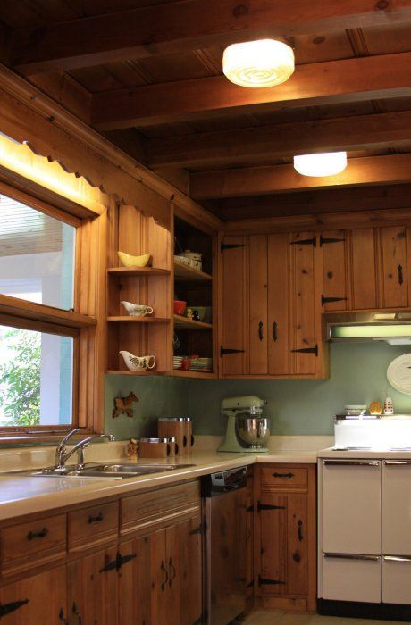 When we bought this house I thought I couldn't wait to get rid of the knotty pine kitchen.  Well, now I kind of fell in love with it and wish I had a knotty pine ceiling to match!